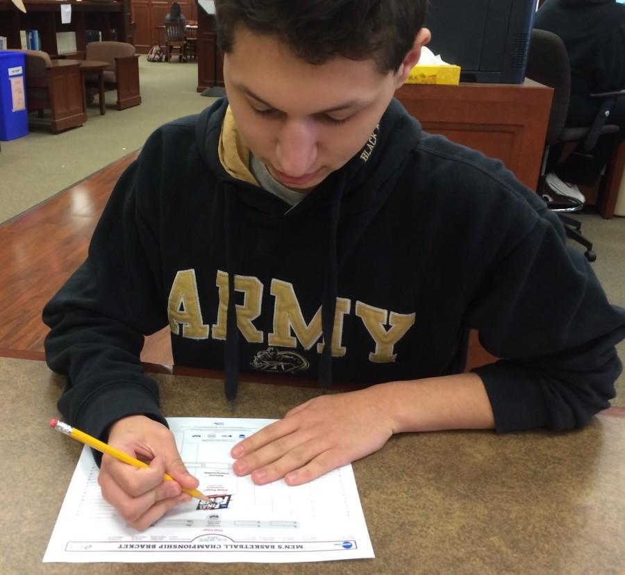 Senior Nick Russolillo filling out a printable bracket