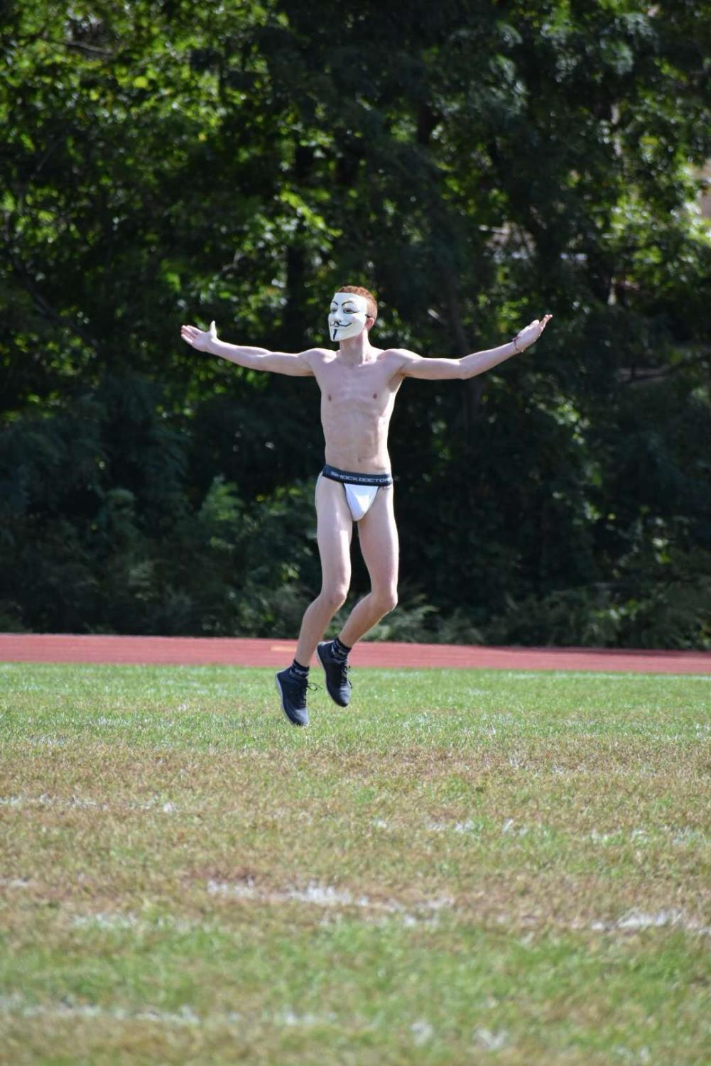The streaker, prancing around the Ward Melville field.