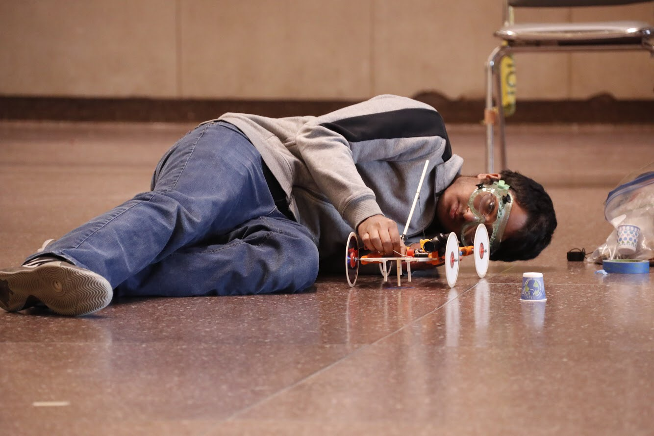 Prakash Sekar, senior, tests out his mousetrap vehicle.
