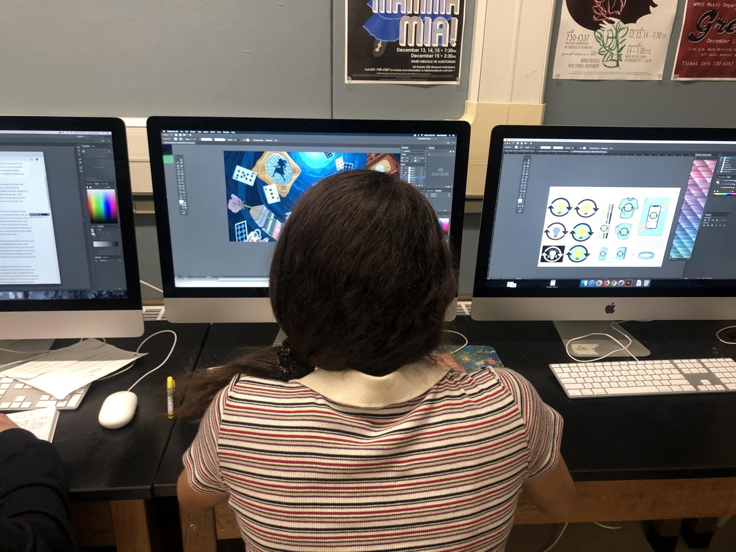 Junior Destiny Sanchez works on her final project in graphic design