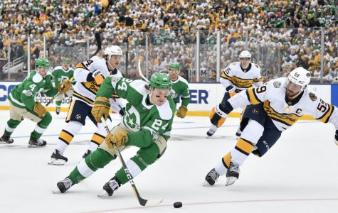 Jan 1, 2020; Dallas, TX, USA; Dallas Stars left wing Roope Hintz (24) is chased by Nashville Predators defenseman Roman Josi (59) during the third period in the 2020 Winter Classic hockey game at Cotton Bowl Stadium. Mandatory Credit: Jerome Miron-USA TODAY Sports